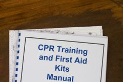 CPR Training and First Aid Kits manual concept. With cover page of a book Royalty Free Stock Images