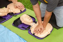 Free CPR Trainning To A Patient Sudden Cardiac Arrest With Patient Model. Stock Photo - 124031530