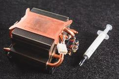CPU从个人计算机和热量油膏的热坠子 库存图片