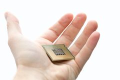 CPU. Computer CPU in human hand isolated on white Royalty Free Stock Photos