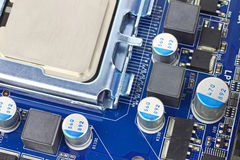 CPU on board. Digital hardware closeup. Microchips and condensers assembly on the circuit board macro Stock Photography