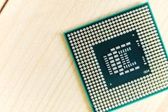 CPU or Computer processor on wooden background Stock Photography