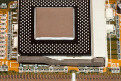 CPU Central processing unit microchip installed in socket Royalty Free Stock Image