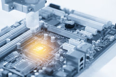The CPU chip on computer main board. Hi-technology concept Stock Image