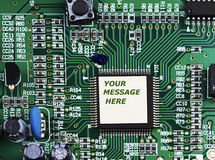 CPU computer circuit motherboard macro closeup with white ad cop Royalty Free Stock Photography
