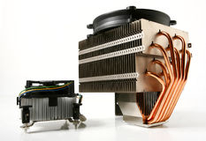Cpu cooler. A nice representation of a difference in size of a cpu cooler, probably a difference in efficiency too. you can clearly see heat pipes Royalty Free Stock Image