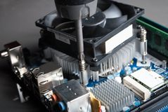 Cpu cooler installation on motherboard with screwdriver royalty free stock photography