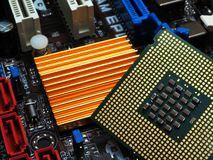 CPU and golden heatsink Stock Photos