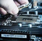 CPU in hand Stock Photo