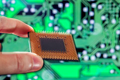 CPU with legs in a hand. Royalty Free Stock Photography