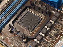 CPU socket on computer motherboard. CPU socket and PCI slots on computer motherboard Royalty Free Stock Image