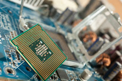 CPU socket and processor on the motherboard. Before installation processor Stock Photo