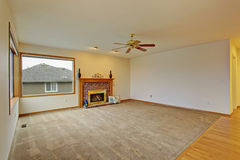 Cpzy unfurnished living room with carpet. Stock Photography