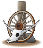Cráneo del buey contra la rueda de carro