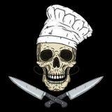 Cráneo en toca con los cuchillos Cráneo de la historieta Cráneo del cocinero Fotos de archivo