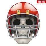 Cráneo humano con el casco del jugador de fútbol americano Fotografía de archivo libre de regalías