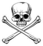 Cráneo y bandera pirata Foto de archivo libre de regalías