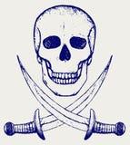 Cráneo y espadas cruzadas Imágenes de archivo libres de regalías