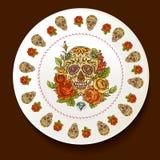 Cráneo y flores en una placa blanca stock de ilustración