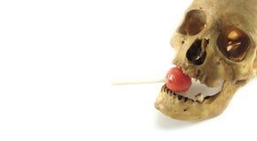 Cráneo y lollipop imagenes de archivo