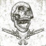 Cráneo y pistolas Foto de archivo