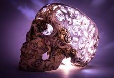 Crâne avec le modèle découpé sur le gradient bleu Photos stock