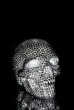 Crâne en métal avec les points réfléchis brillants Photographie stock libre de droits