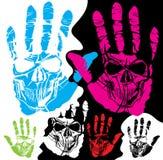 Crâne et main Photographie stock
