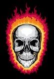 Crâne humain avec des flammes Photographie stock libre de droits