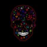 Crâne humain avec des fleurs et des papillons Photographie stock