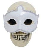 Crâne humain portant un masque Photographie stock libre de droits