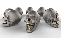 Crânes avec les dents d'or Images libres de droits