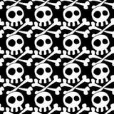 Crânes sans couture et fond croisé d'os Image stock
