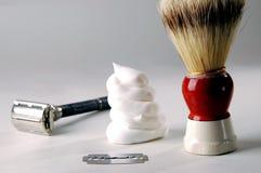 Crème à raser et rasoir Photographie stock