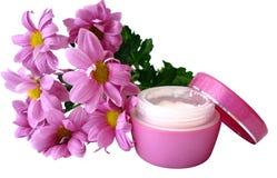 Crème avec des fleurs Photo stock
