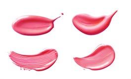 Crème cosmétique de calomnie de vernis à ongles d'isolement sur le fond blanc Calomnie liquide rose témoin de rouge à lèvres images libres de droits