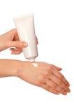 Crème cosmétique pour des mains Images libres de droits