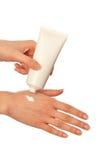 Crème cosmétique pour des mains Photos stock