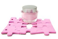 Crème d'humidification et puzzle Images stock