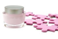 Crème d'humidification et puzzle Photos stock