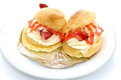 Crème de Chou de fraise Photos libres de droits
