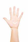 Crème de main peinte par sourire sur la paume Image libre de droits