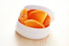 Crème de visage orange images stock
