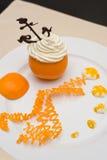 Crème fouettée dans l'orange Photos stock