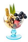 Crème glacée avec des écrous et des fruits Photos libres de droits