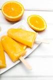 Crème glacée orange faite maison Photos stock