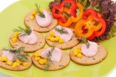 Crème sur des biscuits Images stock