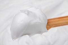 Crème sur le bâton en bois Photographie stock