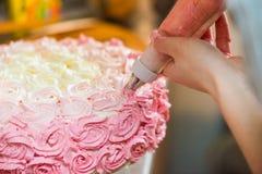 Crème sur le gâteau Photographie stock