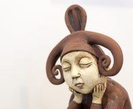 Créature brune de pensée triste d'elfe Photo stock